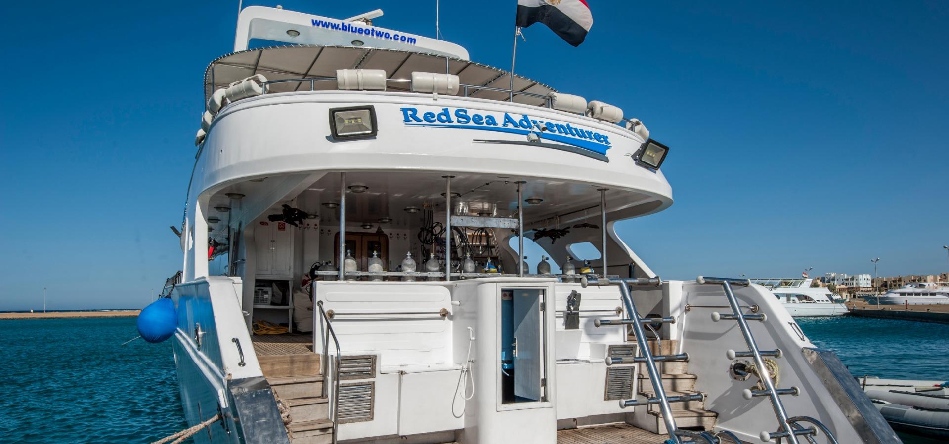Stern of M/Y Red Sea Adventurer liveaboard diving vessel docked in Red Sea harbour